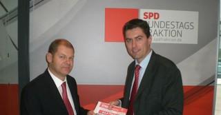 Mit Olaf Scholz, als dieser noch Arbeitsminister war
